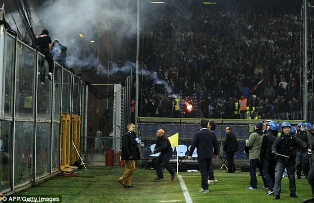 1413370438120 wps 8 Serbian fans L throw fire