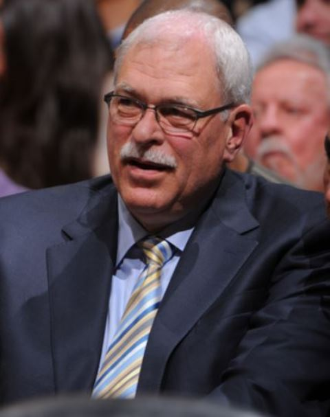 Phil Jackson with mustache looks on wearing sunglasses at Staples Center 2013
